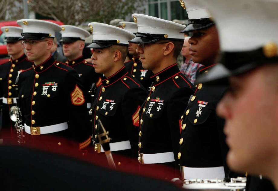 Members of the Marine Corps Band - New Orleans stand at attention following the Joint Service Swearing-In Ceremony at the Houston Livestock Show and Rodeo Wednesday, March 4, 2015, in Houston. Photo: Jon Shapley, Houston Chronicle / © 2015 Houston Chronicle