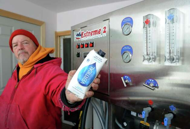 Randy Grippin holds a bottle of Vertical Water flashed pasteurized maple water at his Mountain Winds Farm on Thursday Feb. 26, 2015 in Berne, N.Y. The Grippin farm is one of a handful of businesses in the region that is selling maple water ,also known as sap, which is boiled to make syrup , as an alternative to sports energy drinks. The water is purchased and marketed by a company from Pittsfield, Mass., and is now being sold nationally. This company, Vertical Water, is apparently buying from a number of New York maple farms(Michael P. Farrell/Times Union) Photo: Michael P. Farrell / 00030771A