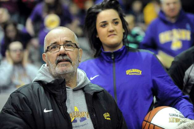 UAlbany's Peter Hooley's father, Jeff Hooley, left, and twin sister, Emma Hooley, attend their basketball game against Hartford on Friday, Feb. 20, 2015, at SEFCU Arena in Albany, N.Y. (Cindy Schultz / Times Union) Photo: Cindy Schultz / 00030640A