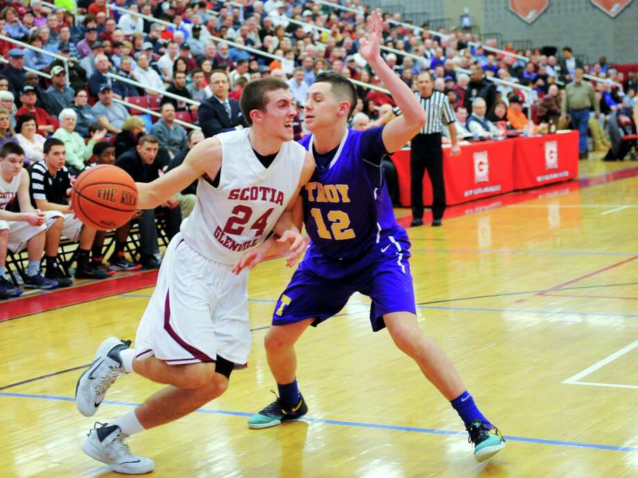 Scotia-Glenville's Joe Cremo (24) is defended by Troy's Zach Radz (12) during their Section II Class A Boys' Championship High School Basketball game in Guilderland, N.Y., Saturday, March 7, 2015. (Hans Pennink / Special to the Times Union) ORG XMIT: HP110 Photo: Hans Pennink / 10030884A