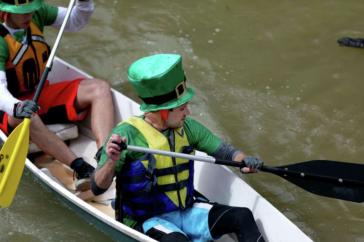 Paddlers Matt Stephens and Clay Hutchins in the 43rd Annual Buffalo Bayou Regatta, a 15-mile American Canoe Association (ACA) sanctioned race, along the scenic Buffalo Bayou Saturday, March 7, 2015, in Houston, Texas.