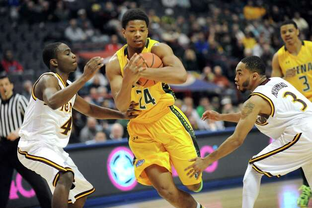 Siena's Lavon Long, center, controls the ball as Iona's Schadrac Casimir, left, and Ibn Muhammad defend during their quarterfinal game of the MAAC Championship on Saturday, March 7, 2015, at Times Union Center in Albany, N.Y. (Cindy Schultz / Times Union) Photo: Cindy Schultz, Albany Times Union / 00030912A