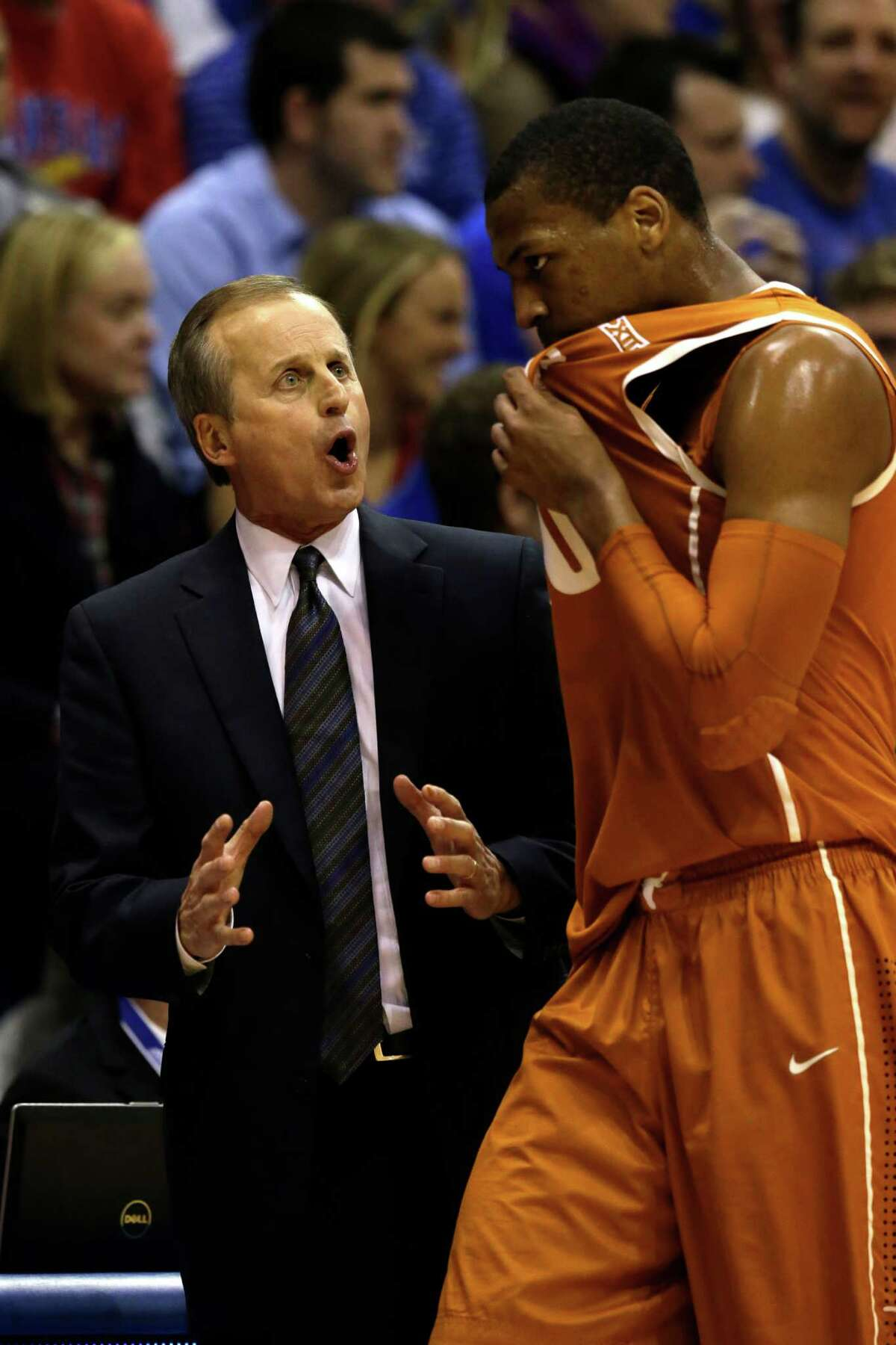 Texas head coach Rick Barnes and forward Jonathan Holmes (10) during the first half of an NCAA college basketball game at Allen Fieldhouse in Lawrence, Kan., Saturday, Feb. 28, 2015. (AP Photo/Orlin Wagner)