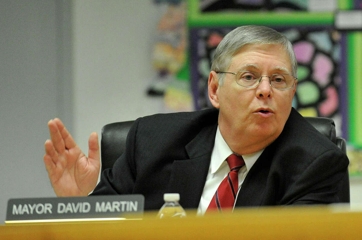 Mayor David Martin asks a question of Board of Education attorney Tom Mooney during the Board of Education meeting at the Stamford Government Center in Stamford, Conn., on Tuesday, Dec. 2, 2014. The meeting dealt with the ramifications of the Stamford High School teacher sex scandal.