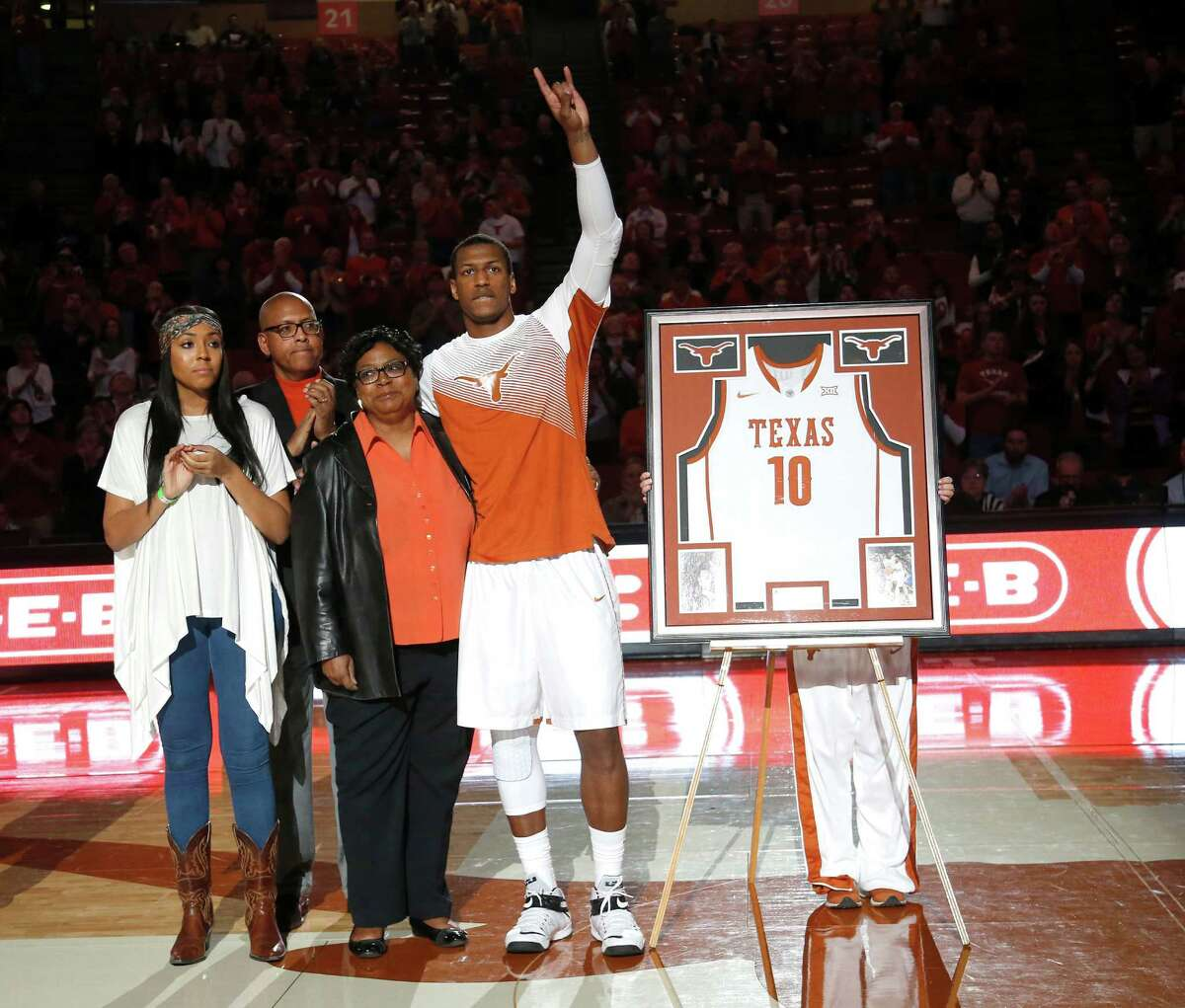 AUSTIN, TX - MARCH 7: Jonathan Holmes #10 of the Texas Longhorns, with his family, is honored on senior day before the game between the Texas Longhorns and the Kansas State Wildcats at the Frank Erwin Center on March 2, 2015 in Austin, Texas. (Photo by Chris Covatta/Getty Images)