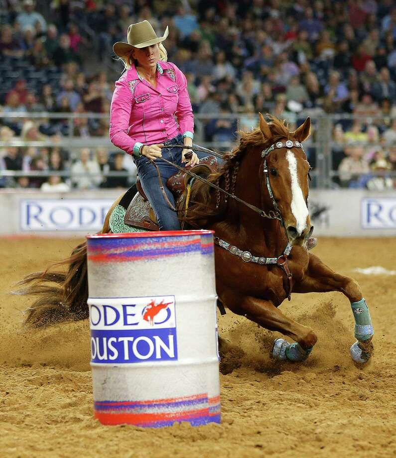 Ann Scott competes in the barrel racing competition during the Houston Livestock Show and Rodeo at NRG Park, Saturday, March 7, 2015, in Houston. Photo: Karen Warren, Houston Chronicle / © 2015 Houston Chronicle