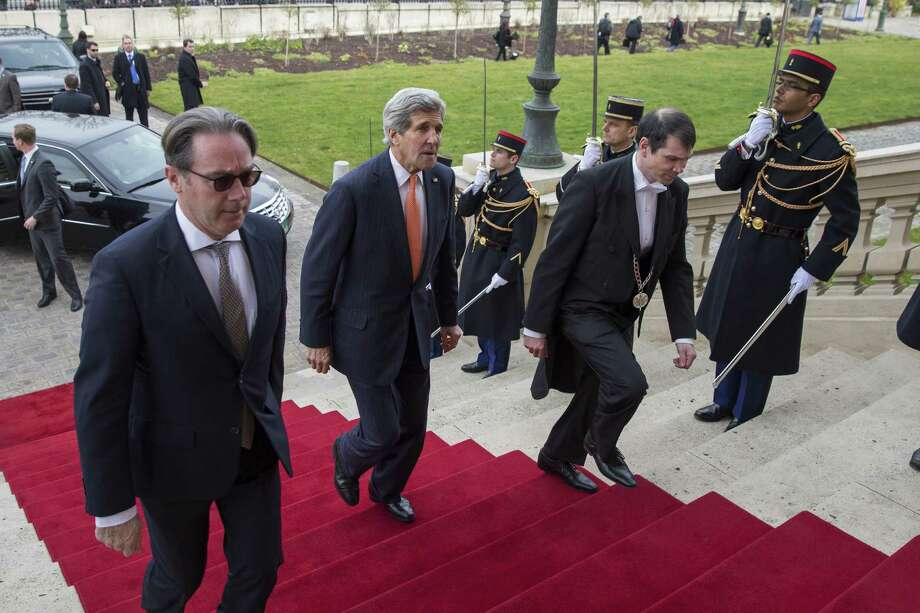 U.S. Secretary of State John Kerry (center) arrives to meet French Foreign Minister Laurent Fabius on Saturday.March 7, 2015, in Paris. Kerry is meeting with the foreign ministers of France, Germany, and Britain about the status of nuclear negotiations with Iran. AFP PHOTO/ POOL / EVAN VUCCIEvan Vucci/AFP/Getty Images Photo: Evan Vucci /Getty Images / AFP