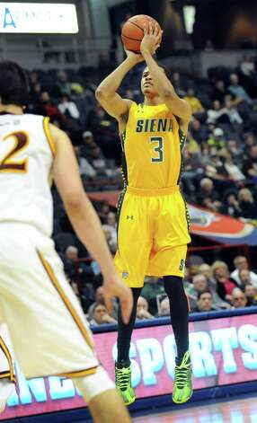 Siena's Ryan Oliver aims a three-point shot during their quarterfinal game against Iona in  the MAAC Championship on Saturday, March 7, 2015, at Times Union Center in Albany, N.Y. (Cindy Schultz / Times Union) Photo: Cindy Schultz / 00030912A