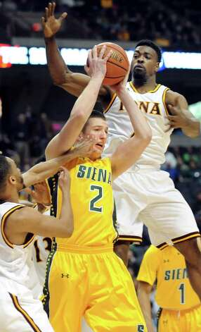 Siena's Willem Brandwijk, center, hangs onto a rebound as Iona's Ibn Muhammad, left, and Kelvin Amayo defend during their quarterfinal game of the MAAC Championship on Saturday, March 7, 2015, at Times Union Center in Albany, N.Y. (Cindy Schultz / Times Union) Photo: Cindy Schultz / 00030912A