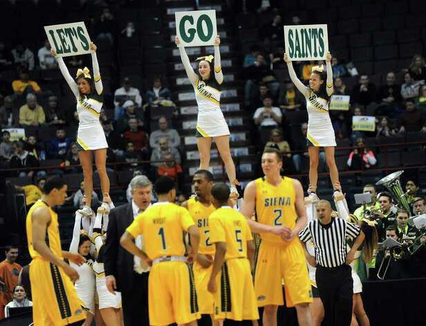 Siena's cheer team show their skills during a timeout in their quarterfinal game against Iona in the MAAC Championship on Saturday, March 7, 2015, at Times Union Center in Albany, N.Y. (Cindy Schultz / Times Union) Photo: Cindy Schultz / 00030912A