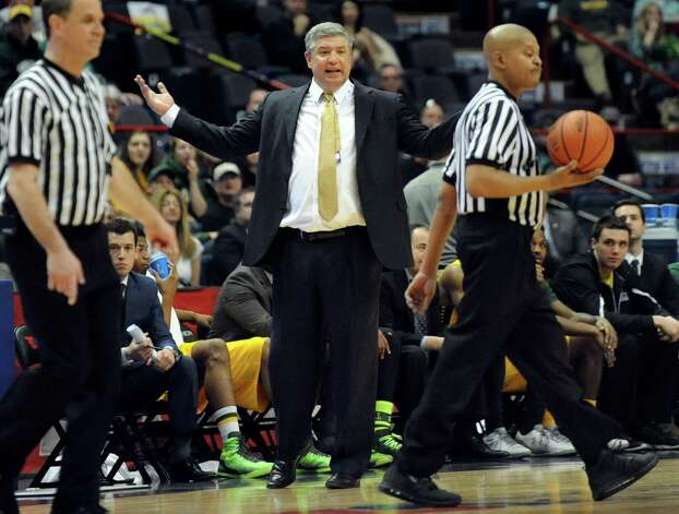 Siena's coach Jimmy Patsos, center, shows his displeasure on a call during their quarterfinal game against Iona in the MAAC Championship on Saturday, March 7, 2015, at Times Union Center in Albany, N.Y. (Cindy Schultz / Times Union) Photo: Cindy Schultz / 00030912A