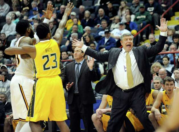 Siena's coach Jimmy Patsos, right, disputes a call during their quarterfinal game against Iona in the MAAC Championship on Saturday, March 7, 2015, at Times Union Center in Albany, N.Y. (Cindy Schultz / Times Union) Photo: Cindy Schultz / 00030912A