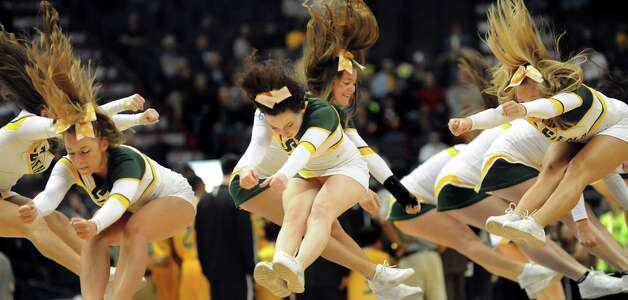 Siena's cheer team perform during a timeout in their quarterfinal game against Iona in the MAAC Championship on Saturday, March 7, 2015, at Times Union Center in Albany, N.Y. (Cindy Schultz / Times Union) Photo: Cindy Schultz / 00030912A