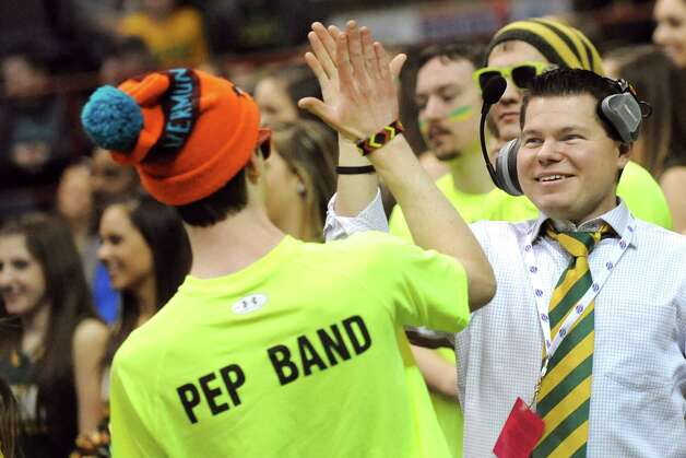 Siena's pep band director Chris Farrell, right, and drummer Michael Cesario cap off a good song during their quarterfinal game against Iona in the MAAC Championship on Saturday, March 7, 2015, at Times Union Center in Albany, N.Y. (Cindy Schultz / Times Union) Photo: Cindy Schultz / 00030912A
