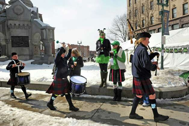 Sixteen-year-old Molly Biittig, right, on bagpipes of the Scotia-Glenville Pipe Band leads her 14-year-old twin brothers Ben and Ryan Biittig as they march during the Collar City Kilt Fest on Saturday March 7, 2015 in Troy, N.Y.  (Michael P. Farrell/Times Union) Photo: Michael P. Farrell / 00030325A