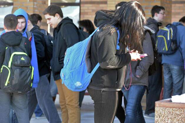 A student uses her smart phone outside Guilderland High after school Friday March 6, 2015, in Guilderland Center, NY.  (John Carl D'Annibale / Times Union) Photo: John Carl D'Annibale / 00030916A
