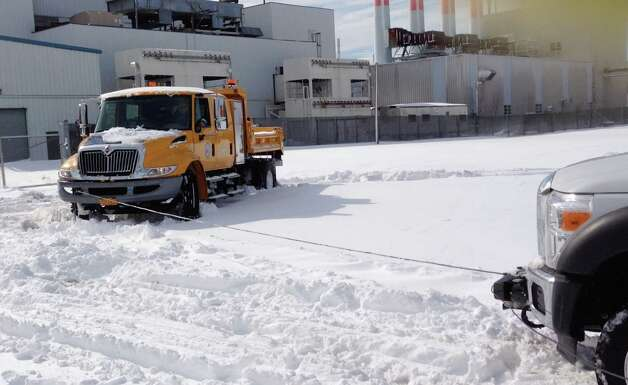 "A ""high-axle"" rescue truck that was part of a special fleet ordered by Gov. Andrew Cuomo is pulled out of the snow after it became stuck during Winter Storm Nemo in February 2013 on Long Island. The ""all-weather"" trucks have proven to be unsuitable in snow and high waters. (Photo from a private video obtained by Times Union)"