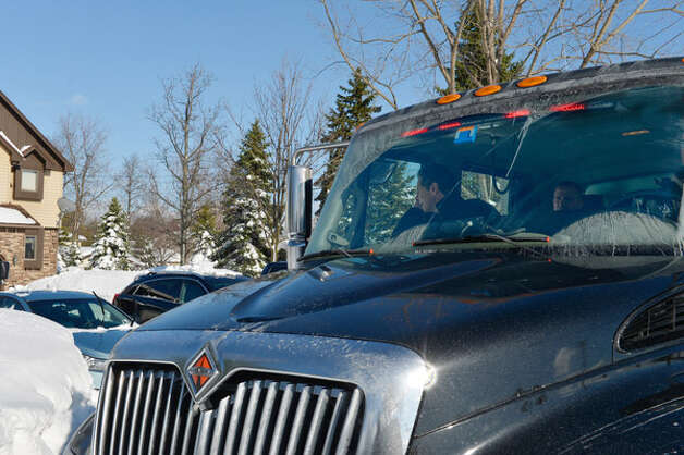 "Gov. Andrew Cuomo rides in a ""high-axle"" truck after a November 2014 snowstorm in Buffalo. Cuomo ordered the purchase of four all-weather trucks following tropical storms in 2011, but Homeland Security officials said the vehicles are not suitable for floods or heavy snow. (Office of the Governor) Photo: Darren McGee"