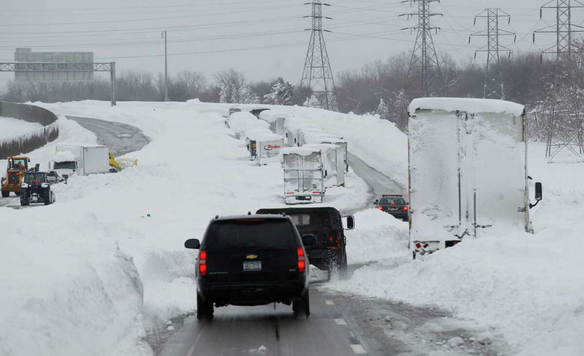 Gov. Andrew Cuomo's motorcade drives on the Thruway past abandoned vehicles near Cheektowaga, N.Y., Wednesday, Nov. 19, 2014. (AP Photo/The Buffalo News, Sharon Cantillon)