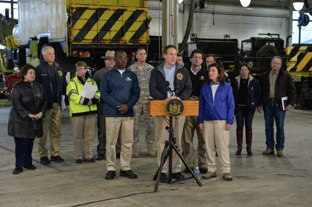 "Gov. Andrew Cuomo holds a press briefing last November following a Buffalo snowstorm. One of four ""all-weather"" trucks he ordered the state to purchase is in the background. Photo: Darren McGee"