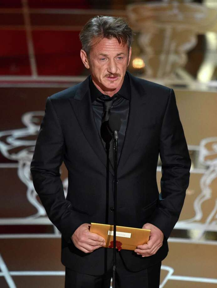 "FILE - In this Feb. 22, 2015 file photo, actor Sean Penn presents the award for best picture to Mexican-born Alejandro Iñárritu for his film, ""Birdman: Or (The Unexpected Virtue of Ignorance),"" at the Oscars at the Dolby Theatre in Los Angeles. On Saturday, March 7,  during a promotional tour for his new film ""The Gunman,"" in Beverly Hills, Penn opened up about the green card joke he made during the Oscars saying that he has ""absolutely no apologies"" for his comment. ""I found it hilarious,"" Iñárritu said after the ceremony. ""Sean and I have that kind of brutal (relationship) where only true friendship can survive."" Iñárritu directed Penn in the 2003 film ""21 Grams"" and the two remain close to this date. (Photo by John Shearer/Invision/AP, File) Photo: John Shearer, John Shearer/Invision/AP / Invision"