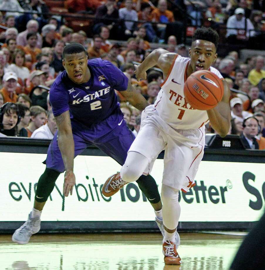 Texas guard Isaiah Taylor (1) drives around Kansas State guard Marcus Foster (2) during the second half of an NCAA college basketball game, Saturday, March 7, 2015, in Austin, Texas. Texas won 62-49. (AP Photo/Michael Thomas) Photo: Michael Thomas, Associated Press / FR65778 AP