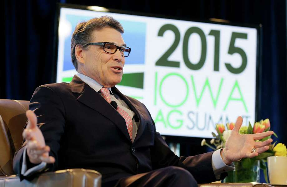 Former Texas Gov. Rick Perry speaks during the Iowa Agriculture Summit, Saturday, March 7, 2015, in Des Moines, Iowa. (AP Photo/Charlie Neibergall) Photo: Charlie Neibergall, STF / AP
