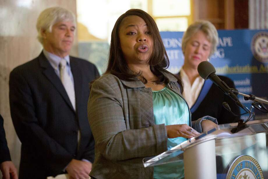 Lavinia Masters, a victim whose case was solved 20 years later after her rape kit was tested, spoke last year at a news conference where Mayor Annise Parker announced the clearing of thousands of rape kits. Photo: Johnny Hanson, Staff / © 2014  Houston Chronicle