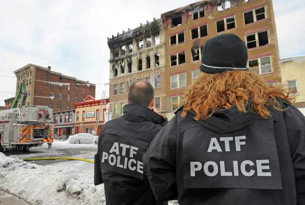 Special agents from the ATF investigate the scene of a fire on Jay Street  Saturday March 7, 2015 in Schenectady, N.Y. That federal agency is in charge of the investigation and demolition, which starts Sunday, March 8, 2015 (Michael P. Farrell/Times Union) Photo: Michael P. Farrell / 00030929A