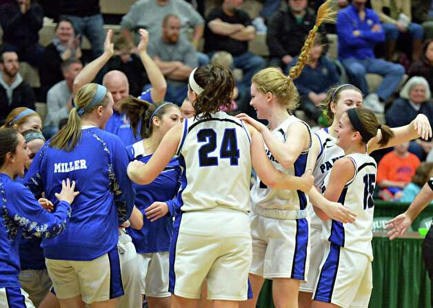 Hoosick Falls players celebrate their win over Watervliet in the Class B girls' basketball final at Hudson Valley Community College Saturday March 7, 2015 in Troy, NY. (John Carl D'Annibale / Times Union) Photo: John Carl D'Annibale / 10030883A
