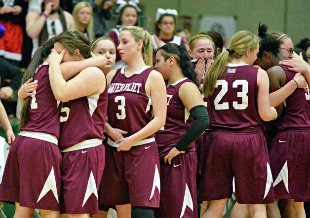 Watervliet players react to their loss to Hoosick Falls in the Class B girls' basketball final at Hudson Valley Community College Saturday March 7, 2015 in Troy, NY. (John Carl D'Annibale / Times Union) Photo: John Carl D'Annibale / 10030883A