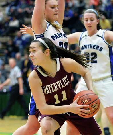 Watervliet's #11 Meghan Capone gets around Hoosick Falls defenders during the Class B girls' basketball final at  Hudson Valley Community College Saturday March 7, 2015 in Troy, NY. (John Carl D'Annibale / Times Union) Photo: John Carl D'Annibale / 10030883A