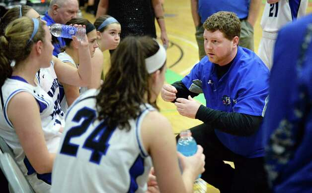 Hoosick Falls head coach Eamonn DeGraaf with players during their Class B girls' basketball final against Watervliet at Hudson Valley Community College Saturday March 7, 2015 in Troy, NY. (John Carl D'Annibale / Times Union) Photo: John Carl D'Annibale / 10030883A