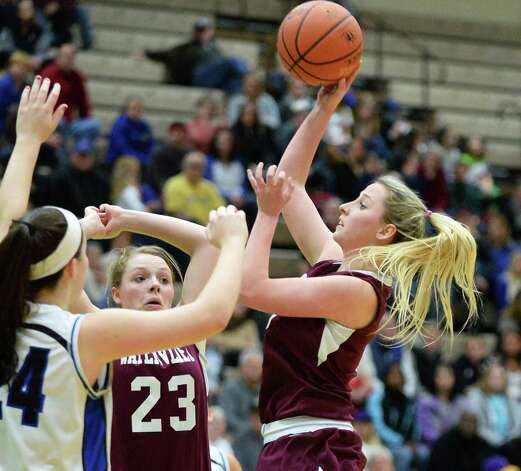 Watervliet's #3 Kiki Szczepanski takes a shot during their Class B girls' basketball final against Hoosick Falls at Hudson Valley Community College Saturday March 7, 2015 in Troy, NY. (John Carl D'Annibale / Times Union) Photo: John Carl D'Annibale / 10030883A