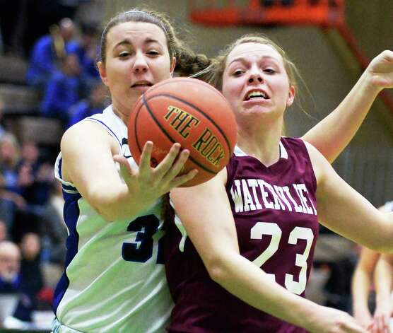 Hoosick Falls' #32 Megan Flynn, left, and Watervliet's #23 Kaila DeLoriea fight for a rebound during the Class B girls' basketball final at  Hudson Valley Community College Saturday March 7, 2015 in Troy, NY. (John Carl D'Annibale / Times Union) Photo: John Carl D'Annibale / 10030883A