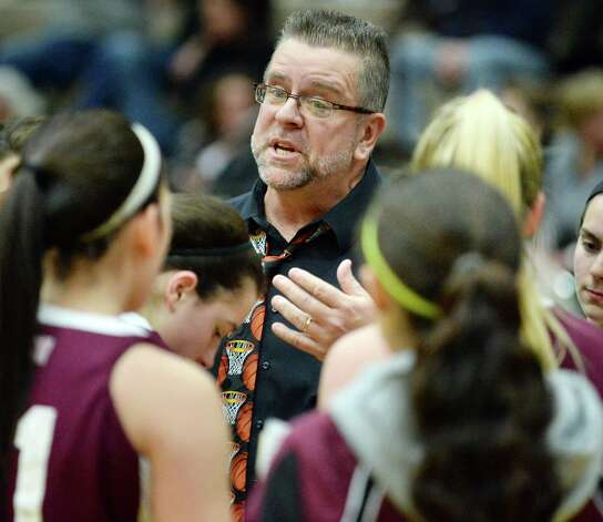 Watervliet head coach Gordie Johnson with players during their Class B girls' basketball final against Hoosick Falls at Hudson Valley Community College Saturday March 7, 2015 in Troy, NY. (John Carl D'Annibale / Times Union) Photo: John Carl D'Annibale / 10030883A