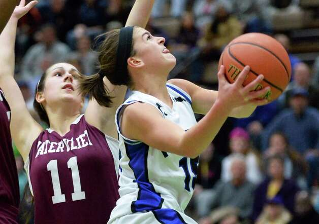 Hoosick Falls' #15 Lizza Ryan, right, drives past Watervliet's #11 Meghan Capone during the Class B girls' basketball final at  Hudson Valley Community College Saturday March 7, 2015 in Troy, NY. (John Carl D'Annibale / Times Union) Photo: John Carl D'Annibale / 10030883A