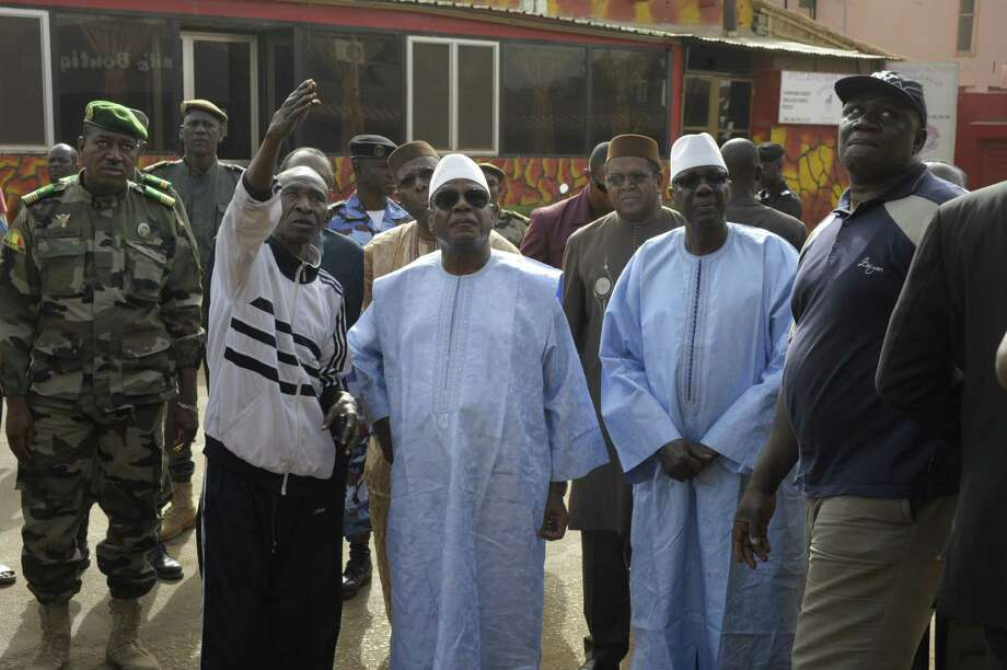 Mali's President Ibrahim Boubacar Keita (center)  arrives at La Terrasse bar and restaurant in Bamako after five people  were shot dead in an overnight attack. Photo: AFP Photo /Getty Images / AFP