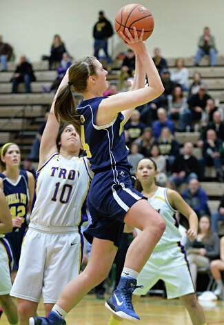 Averill Park's #4 Jenna Miner gets a shot off as Troy's #10 Sabrina Wolfe, left, defends during their Class A girls' basketball final Saturday March 7, 2015 at Hudson Valley Community College in Troy, NY.   (John Carl D'Annibale / Times Union) Photo: John Carl D'Annibale / 10030882A