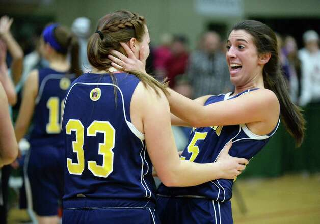 Averill Park's #33 Caraline Wood, left, and #15 Lauren Vanroy celebrate their Class A girls' basketball win over Troy High Saturday March 7, 2015 at Hudson Valley Community College in Troy, NY.   (John Carl D'Annibale / Times Union) Photo: John Carl D'Annibale / 10030882A