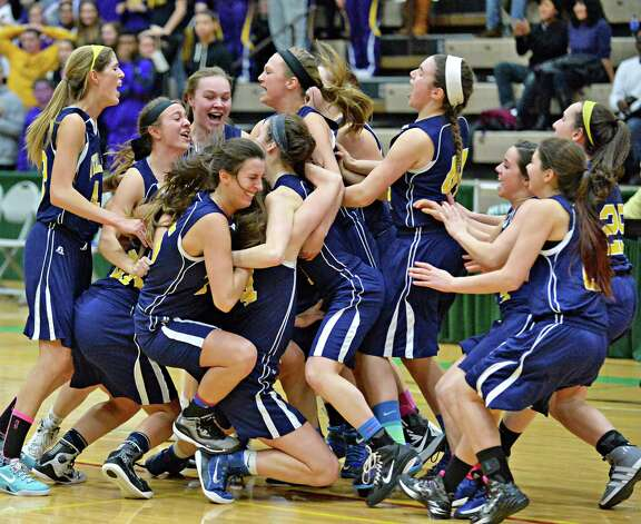 Averill Park players celebrate their Class A girls' basketball win over Troy High Saturday March 7, 2015 at Hudson Valley Community College in Troy, NY.   (John Carl D'Annibale / Times Union) Photo: John Carl D'Annibale / 10030882A