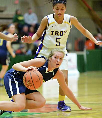 Troy's #5 Shalie Frierson, top, and Averill Park's  #30 Samantha Laranjo during the Class A girls' basketball final Saturday March 7, 2015 at Hudson Valley Community College in Troy, NY.   (John Carl D'Annibale / Times Union) Photo: John Carl D'Annibale / 10030882A