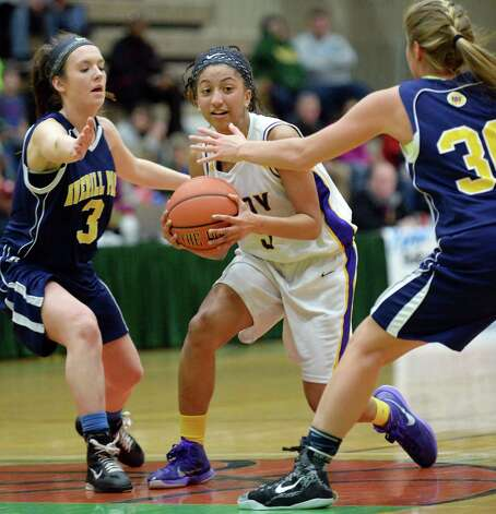 Troy's #4 Kiana Patterson is double teamed by Averill Park's #3 Alyssa Anthony, left, and #30 Samantha Laranjo, right, during the Class A girls' basketball final Saturday March 7, 2015 at Hudson Valley Community College in Troy, NY.   (John Carl D'Annibale / Times Union) Photo: John Carl D'Annibale / 10030882A