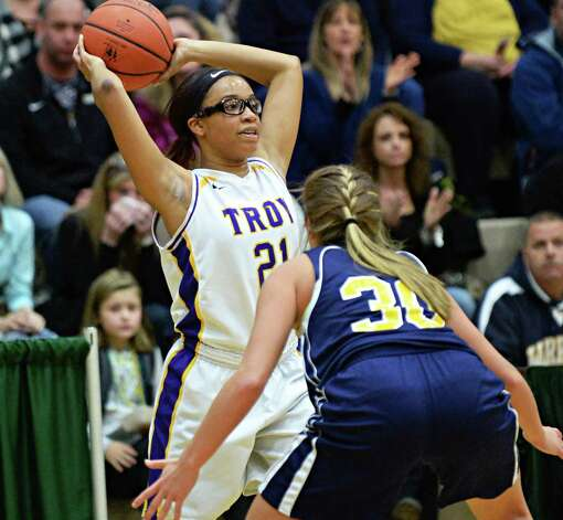 Troy's #21 Alliyah Gilespie, left, tries to get a pass over Averill Park's  #30 Samantha Laranjo during the Class A girls' basketball final Saturday March 7, 2015 at Hudson Valley Community College in Troy, NY.   (John Carl D'Annibale / Times Union) Photo: John Carl D'Annibale / 10030882A