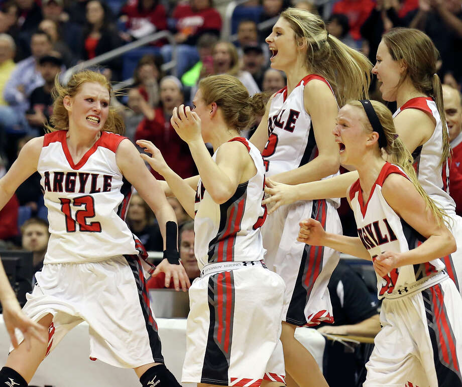 Members of the Argyle Lady Eagles basketball team celebrate their win over the Abilene Wylie Bulldogs in the UIL Class 4A Girl's Basketball State final held Saturday March 7, 2015 at the Alamodome. Argyle won 46-25. Photo: Edward A. Ornelas, Staff / San Antonio Express-News / © 2015 San Antonio Express-News