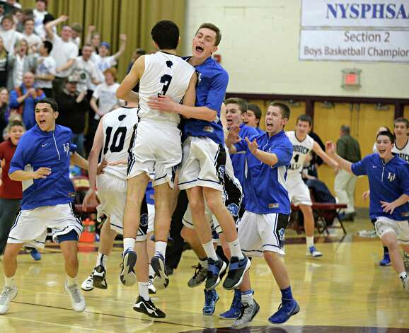 Hoosick Falls players celebrate their Class B boys' basketball final win over Shalmont at Colonie High School Saturday March 7, 2015 in Colonie, NY.  (John Carl D'Annibale / Times Union) Photo: John Carl D'Annibale / 00030907A