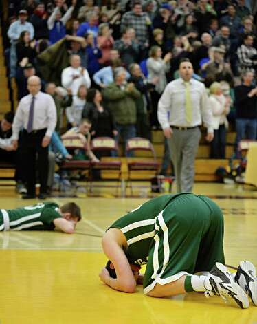 Shalmont players react to their Class B boys' basketball final loss to Hoosick Falls at Colonie High School Saturday March 7, 2015 in Colonie, NY.  (John Carl D'Annibale / Times Union) Photo: John Carl D'Annibale / 00030907A