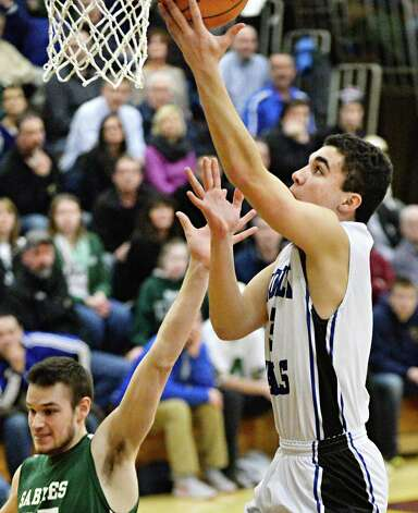 Hoosick Falls' #3 Noah Chani is good for two during their Class B boys' basketball final against Shalmont at Colonie High School Saturday March 7, 2015 in Colonie, NY.  (John Carl D'Annibale / Times Union) Photo: John Carl D'Annibale / 00030907A