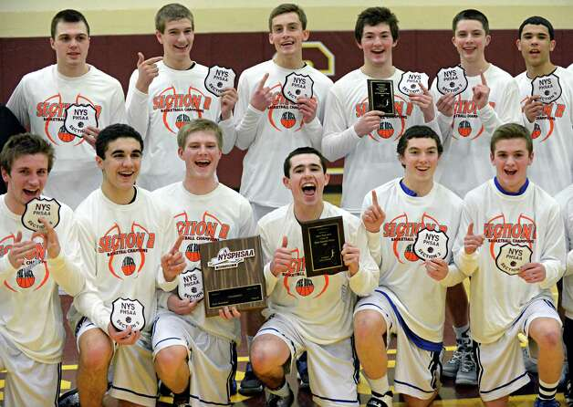 Hoosick Falls players pose for photos after their Class B boys' basketball final win over Shalmont at Colonie High School Saturday March 7, 2015 in Colonie, NY.  (John Carl D'Annibale / Times Union) Photo: John Carl D'Annibale / 00030907A