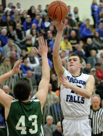 Hoosick Falls' #10 Connor McCart, right, shoots over Shalmont's #43 Matt Bird during the Class B boys' basketball final at Colonie High School Saturday March 7, 2015 in Colonie, NY.  (John Carl D'Annibale / Times Union) Photo: John Carl D'Annibale / 00030907A